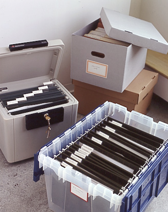 Plastic file boxes are perfect for long-term storage and are water-tight. Cardboard varieties can also be used for long-term storage in a dry place.