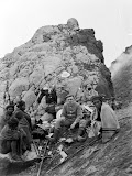 Portrait of Dr. Theophil Wurth and Europeans and Javanese during a break in the climb of Mount Merapi (unknown photographer, 1908) Courtesy TropenMuseum Archives