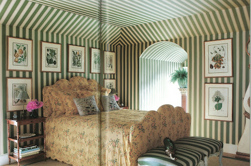 The striped walls create a sense of order and calm.