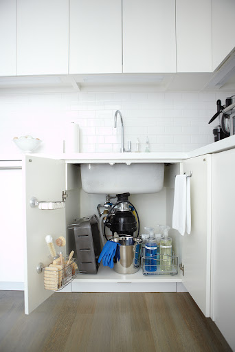 I love the baskets and towel bar mounted to the cabinet doors under my sink.  They keep everything neat and concealed and within easy reach.