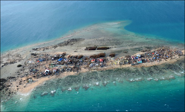This aerial photo shows the devastation on Victory Island off of the town of Guiuan in Eastern Samar province, central Philippines on 11 November 2013, four days after devastating Typhoon Haiyan hit the country. Photo: TED ALJIBE / AFP / Getty Images