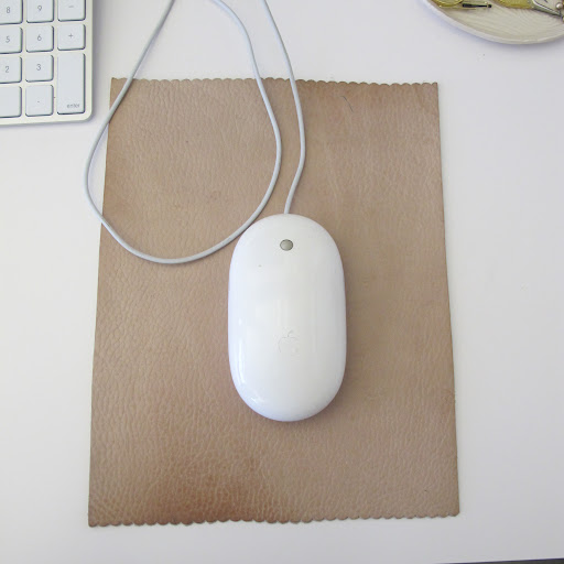 My mouse pad is a piece of leather that I have had for many years. It was a gift from a former colleague. She recently came in for a visit and couldn't believe I still had it.