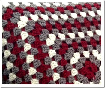 Granny square crochet pillow closeup