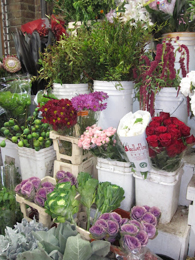 A selection of flowers can be found inside of the store.