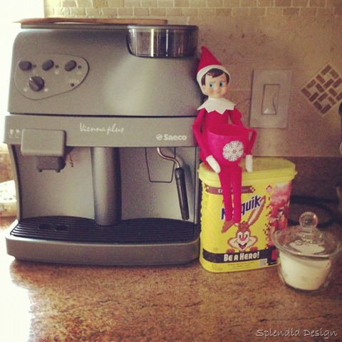 Elf on the Shelf drinking hot chocolate