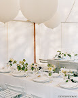 Spice up an all-white color palette with oversized white balloons attached to your centerpieces.