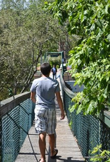 Crossing the swinging bridge