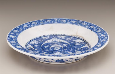 Plate | Origin:  Iznik,  Turkey | Period: ca. 1500  Ottoman period | Details:  This elegant dish combines blossoms, leaves, and crescent-shaped motifs linked by gracefully interlaced and knotted tendrils. It belongs to a group of blue-and-white wares produced in the Turkish city of Iznik during the early sixteenth century. Inspired by manuscript illumination, reverse-painted motifs—some outlined and shaded in dark blue to create a three-dimensional effect—are characteristic of early Iznik ceramics. While the blue-and-white palette and the blossoms circling the interior rim and exterior well recall Chinese porcelains, these elements are now synthesized into a new and original style expressing Ottoman sensitivity and taste. | Type: Composite body painted under glaze | Size: H: 6.5  W: 39.3   D: 39.3  cm | Museum Code: F1954.3 | Photograph and description taken from Freer and the Sackler (Smithsonian) Museums.