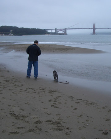Miss Kona and her dad on a beach in San Francisco. Photo by ktnevin.
