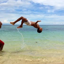 He Ain't Heavy... by Dick Shia - Sports & Fitness Fitness ( backflip, tumbling, nature, kids, beach )