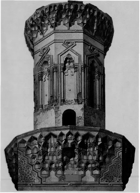 Mosque of Muhammad ihn Qalawaun, view of the minaret, 14th century. Muqamas adorning the mosque's minaret elevate it into the cityscape. The minaret positions the complex on a main avenue of medieval Cairo. Recessed panels, traced by a knotted motif and false columns, distinguish the octagonal trunk