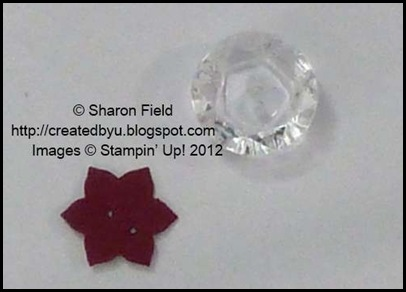 created an easy button star using vintage faceted buttons
