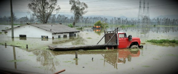 Cota, Colombia &mdash; A truck and a home sit under flood waters after heavy rains triggered the Chico River to overflow its banks in Cota, yesterday. Torrential rains, floods and landslides have killed over a dozen people in Colombia this year. Fernando Vergara / AP Photo