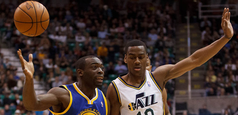 Golden State's Charles Jenkins loses the ball, with Utah Jazz point guard Alec Burks defending