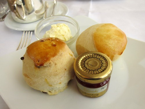 Home-baked English scones Served with clotted cream, rose petal jelly and strawberry preserves
