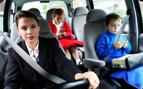 Mother with kids in the car