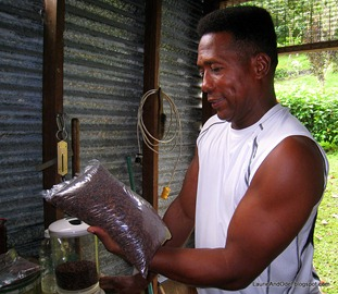 Tito admires the finished cacao beans