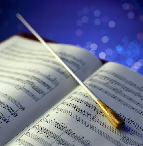 Conductor Baton and Sheet Music
