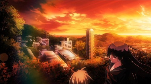The setting autumn sun over a small cityscape overlooked on a the edge of a forested hill by our two protagonists