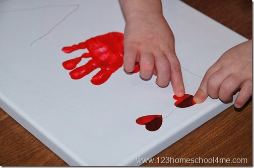 Kids can add heart stickers or stamp with a heart cookie cutter or sponge along the pencil letters.