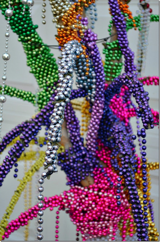 mardi-gras-beads-on-bush