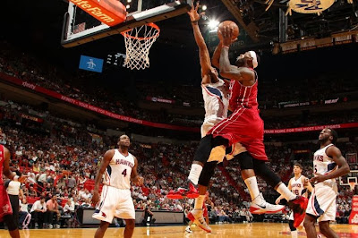 lebron james nba 131223 mia vs atl 01 LeBron James Wears 3 Shoes in 1 Game. Puts Milsap on a Poster.