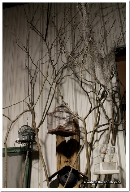 tree branches to display bird cages in antique booth