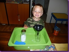 "Pouring ""Milk"" from Milk Jugs (Photo from Chestnut Grove Academy)"