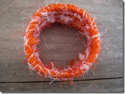 orange and white bracelet
