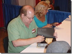 Waid signs stack Baltimore Comic Con  August 20, 2011 021