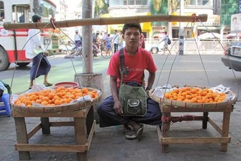Boy Selling Fruit on Rangoon Sidewalk 480