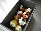 Colorful tomatoes stuffed with herbed goat cheese