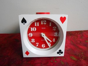Elgin wind up alarm clock with a playing card/poker theme