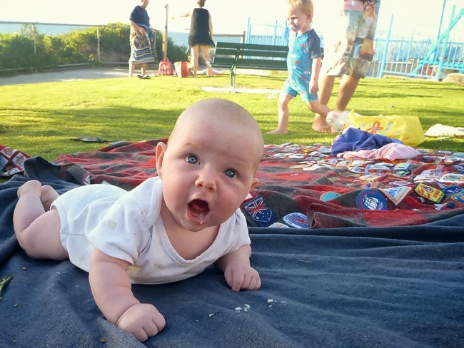 ace - twilight tummy time at the beach - a bit spewy due to the 44 degree heat