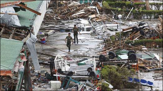 In the wake of Super Typhoon Haiyan, soldiers walk outside of Tacloban's shattered airport terminal, 9 November 2013. Photo: Sky News