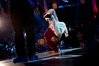 3T of Vietnam performs as Taisuke of Japan watches on during the Red Bull BC One breakdancing world finals at the Circus Nikulin in Moscow, Russian Federation on November 26, 2011.