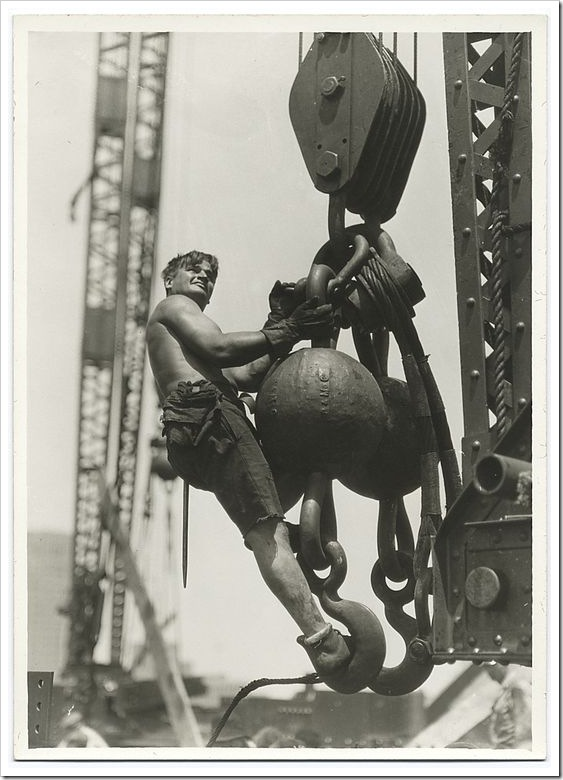 A-worker-riding-on-a-crane-hook-1931