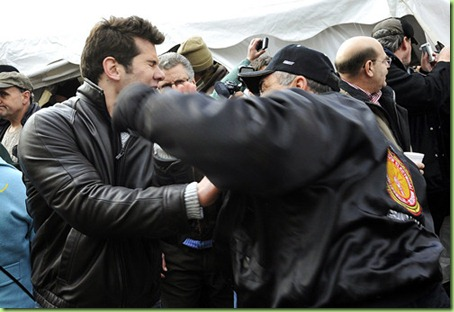 (caption) In this sequence of photos a man in a IBEW Union jacket punches another man in the face outside the pro-Right-to-Work tent of Americans for Prosperity,an organization funded by big money private doners.  *** Union members and labor supporters protest Right-to-Work legislation at the Michigan State Capitol in Lansing Tuesday morning. Photos taken on Tuesday, December 11, 2012. ( John T. Greilick / Detroit News )