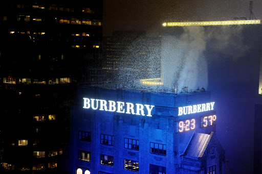 Confetti cannons explode as a part of Burberry's sign lighting ceremony.