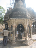 This Nandi shrine, facing the sanctum, is later addition, perhaps during mughal regime when Malwa came under Sindhias. This muslim influence can be seen in the dome roof of this shrine.