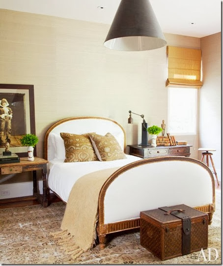 ellen-degeneres-portia-de-rossi-home-guest bedroom architectural digest cococozy louis vuitton upholstered bed wood trim textured seagrass walls