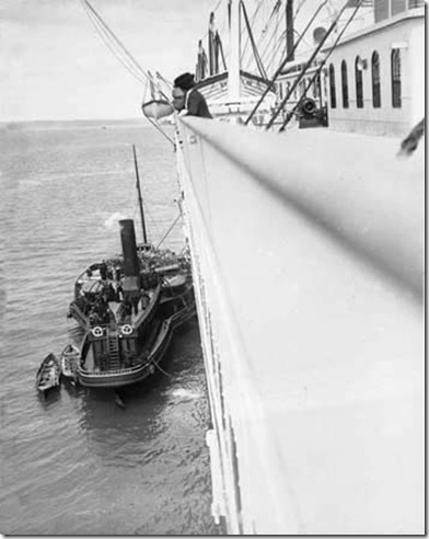 "Cobh Tender ""America"" alongside Titanic"