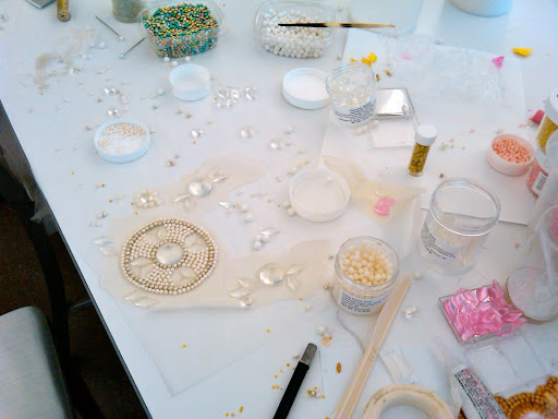 One by one, we glued the Fancy Flours pearls, dragees, and various gems onto muslin to create the finished piece.