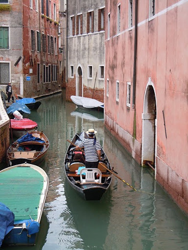 The gondolier is so emblematic of Venice. (atreelinedstreet.com)