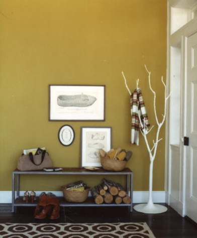 Low hanging art is beautiful in this entryway. (marthastewart.com)