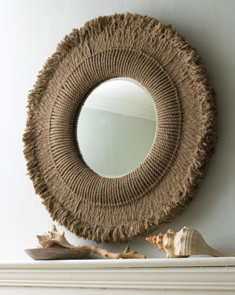 The frayed edges make this mirror look like the sun. (horchow.com)