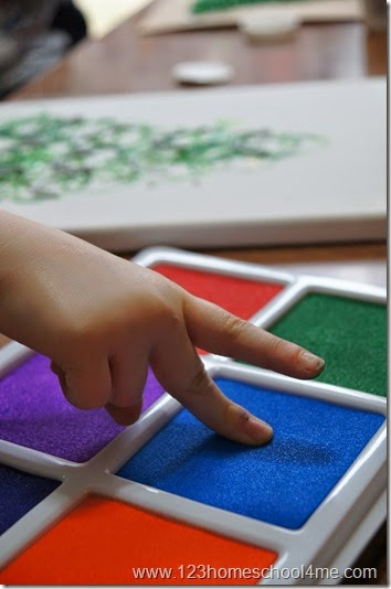 make lights using fingers and a stamp pad