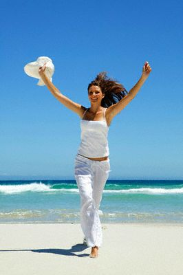 woman walking barefoot beach gif