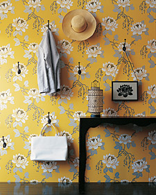 The flowers in this paper create the perfect spot for antique hooks. Voila, an entryway is created. (Blueprint Magazine)