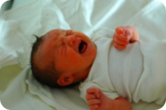 1280px-Crying_newborn